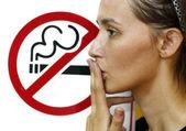 Lady smoking a non-smoking panel — Stock Photo