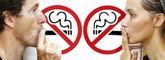 Couple smoking a no smoking sign — Stock Photo