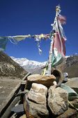 Praying flags and stones in annapurna, nepal — Stock Photo