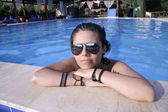 Young woman posing in swimming pool — Stock Photo