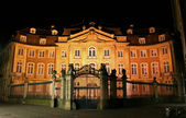 Old mansion illuminated, munster, germany — Stock Photo