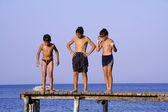 Boys on pier — Stock Photo