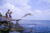 Teenagers in sea — Stock Photo