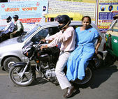 Couple on motorcycle in traffic, delhi, india — Stock Photo