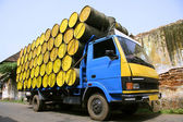 Barrels stacked atop truck, south india — Stock Photo