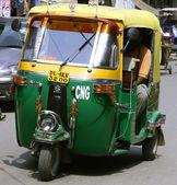 Auto rickshaw driving on road, delhi, india — Stock Photo