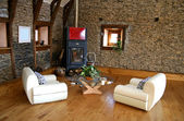 Cozy modern living room with fireplace — Stock Photo