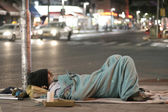 Male homeless sleeping in a street — Stock Photo