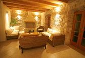 Luxury stone villa interior illuminated at night — Stock Photo