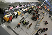 Passengers queuing up for check-in — Stock Photo