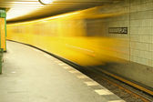 Underground train rushing into station — Stok fotoğraf