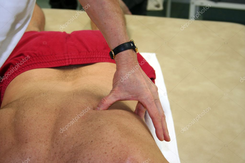Physiotherapist handling patient — Stock Photo #8044554
