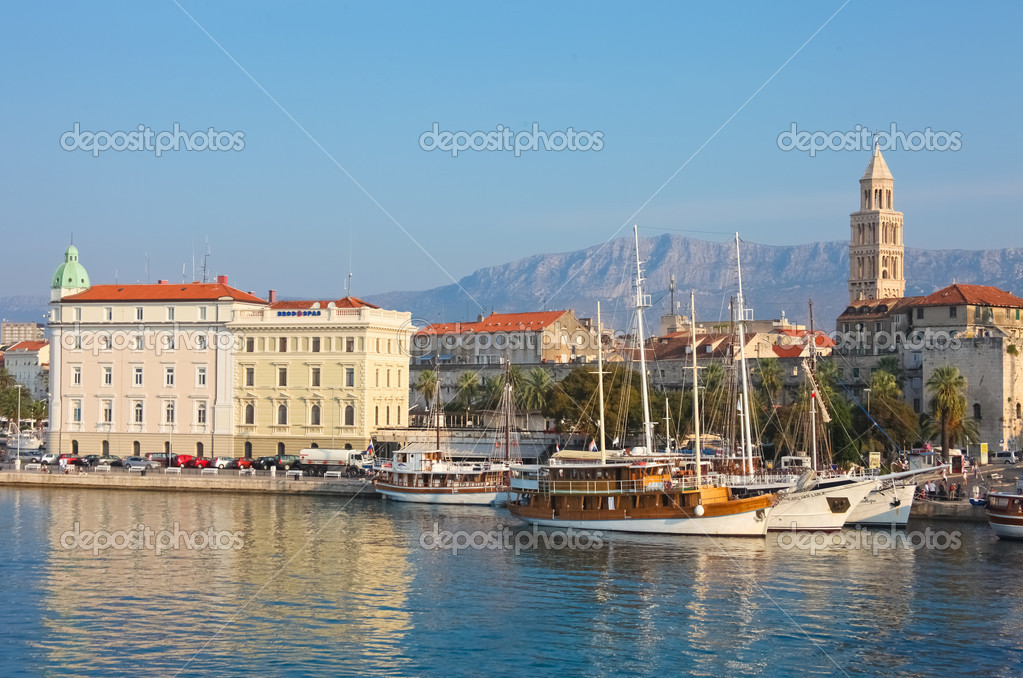 SPLIT - SEPTEMBER 24: Boats in harbour and bell tower on September 24, 2011 in Split, Croatia. The bell tower was originally built in 1100 AD.  Stock Photo #8045814