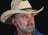 A Man with a Gray Beard in a White Straw Cowboy Hat — Stock Photo