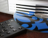 A Compact Disc, Player and Remote Control — Stock Photo