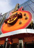 A view of a Hard Rock Cafe guitar from below — Stock Photo