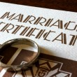 Stock Photo: A Marriage Certificate and Gold Wedding Ring