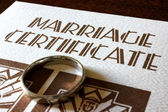 A Marriage Certificate and Gold Wedding Ring — Stock Photo