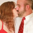 A Middle Aged Married Couple Kissing — Stock Photo #8141159