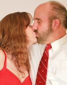A Middle Aged Married Couple Kissing — Стоковое фото