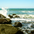 Waves Break on the Rocky Shore of a Blue-Green Sea — Stock Photo #8177340
