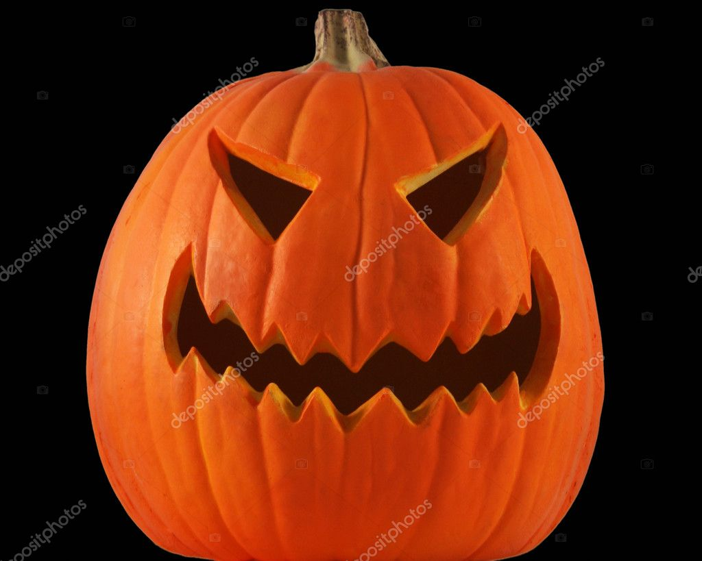 A lone jack-o-lantern with black eyes and mouth grins maniacally on a pitch black Halloween night. — Stock Photo #8176993