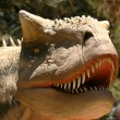 A Carnotaurus in an Early Cretaceous Forest — Stock Photo
