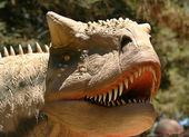 En carnotaurus i en tidig krita skog — Stockfoto