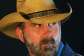 A Bearded Cowboy Glances Over His Shoulder — Stock Photo