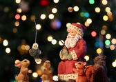 Santa Claus and his woodland friends go fishing on Christmas Eve with multi — Stock Photo