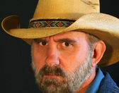 A Bearded Cowboy with a Stern Frown — Stock Photo