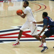 Stock Photo: Defender Chases Kevin Parrom in ArizonBasketball Game