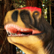 Stock Photo: An Allosaurus Hunts in a Jurassic Forest