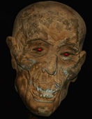 A Mummified Head with Supernatural Red Eyes — Stock Photo