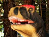 An Allosaurus Hunts in a Jurassic Forest — 图库照片