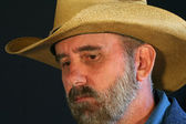 A Bearded Cowboy With a Sad, Pensive Expression — Stock Photo