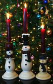 En trio av snögubbe ljus — Stockfoto