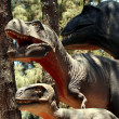 Stock Photo: Tyrannosaurus Family Hunting in Cretaceous Forest