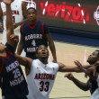 Постер, плакат: A Battle Under the Net in an Arizona Basketball Game