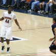 Постер, плакат: Solomon Hill Eyes a Defender in an Arizona Basketball Game