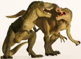 A Spinosaurus and Tyrannosaurus Battle on White — Stock Photo