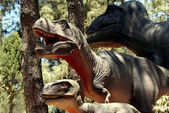 A Tyrannosaurus Family Hunting in a Cretaceous Forest — Стоковое фото