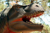 A Tyrannosaurus Hunting in a Cretaceous Forest — Foto Stock