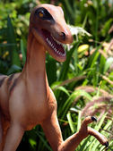 A Velociraptor in a Prehistoric Cretaceous Jungle — 图库照片