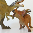 A Spinosaurus and Styracosaurus Battle with White Background - Stock Photo