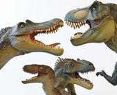 A Spinosaurus, Tyrannosaurus Rex, Velociraptor and Allosaurus — Stock Photo