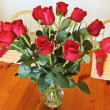 Stock Photo: Dozen Red Roses in Crystal Vase