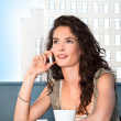 Attractive young business woman talking on cellphone — Stock Photo