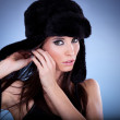 Beautiful young woman with black cap — Stock Photo