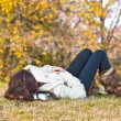 Beautiful girl with book sleeping  on grass — Foto Stock